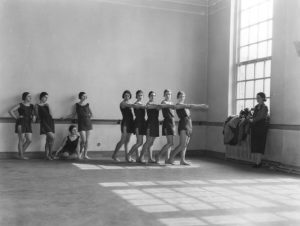 April 1931:  Irish ballerina Dame Ninette de Valois (1898 - 2001) (right) watching pupils at Sadler's Wells Ballet School, London, during a class.  (Photo by Sasha/Getty Images)