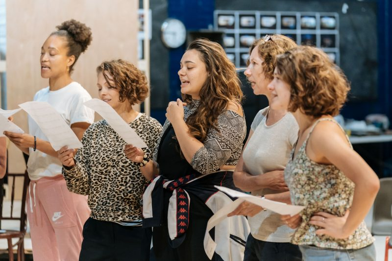 women in cast singing